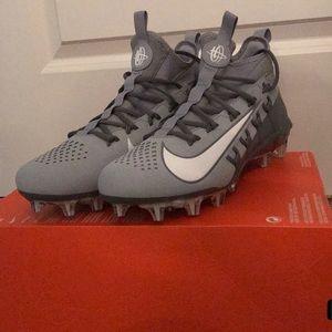 Grey Nike lacrosse cleats